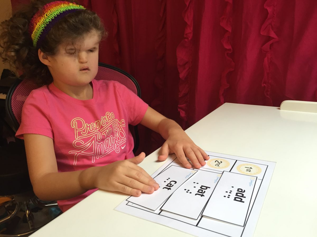 girl reading flashcards at desk