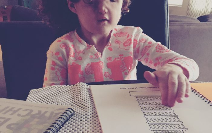 Madilyn reading a tactile picture in braille book